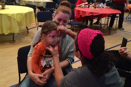 getting her face painted