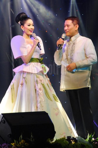 Angelica Coliat answers in confident. Her dress is a floral beige gown by Renee Salud.