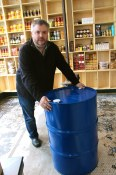 Sean Heather with a barrel of extra virgin olive oil at Rainier Provisions