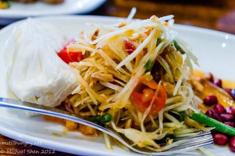 Spice I Am Som Tum (Green Papaya Salad) - Salad with sour & spicy taste, dried shrimp, peanuts and chilli.