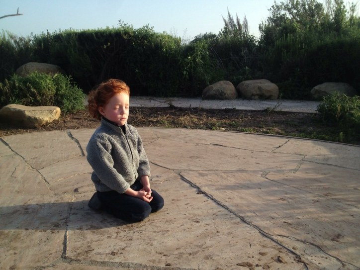 Devin in the bird sanctuary, meditating.