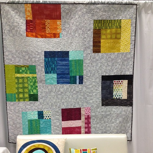 My quilt is in the @michaelmillerfabrics booth! Fabric is #edges by @lauragunnstudio #quiltcon