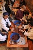 Staff Winnowing Cacao at Eastvan Roasters