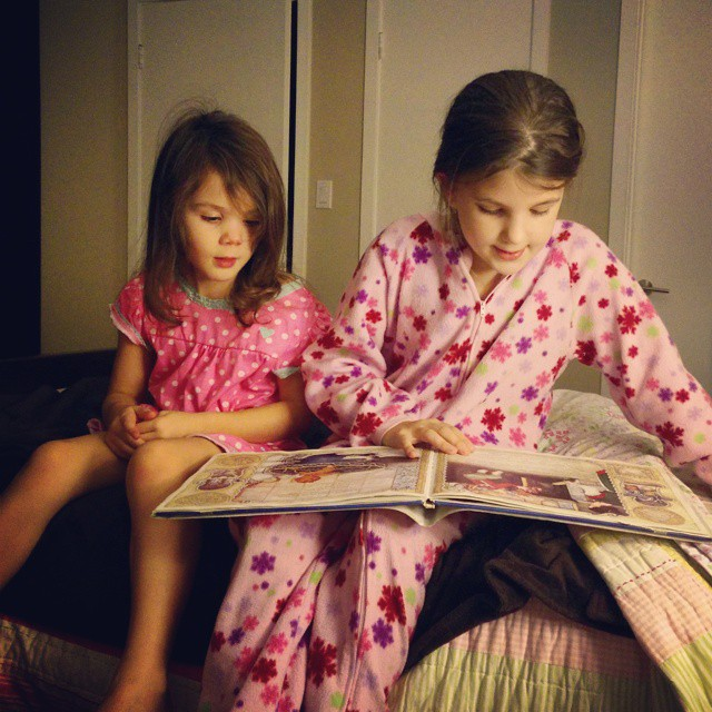 Reading bedtime stories last night... They take turns and I can't bear to ask them to stop... which, you know, I guess is a good stall tactic on their part. :-) #raisingreaders  #homeschool  #magicalchildhood