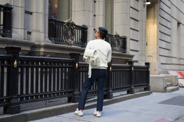 Fashion blogger Bryanboy carrying a white leather Gucci backpack