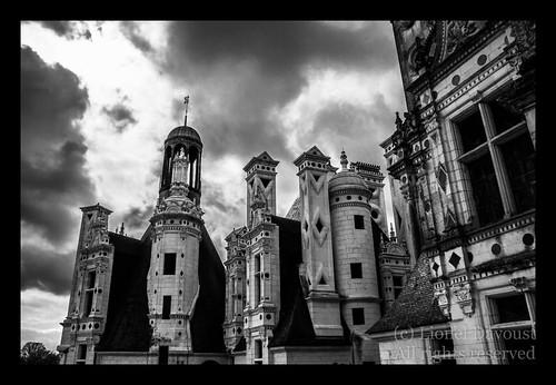 Chambord castle under a dramatic sky