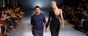 Designer Anthony Vaccarello appears with Polish model Anja Rubik at the end of his Fall/Winter 2012-2013 women's ready-to-wear fashion show during Paris fashion week February 28, 2012