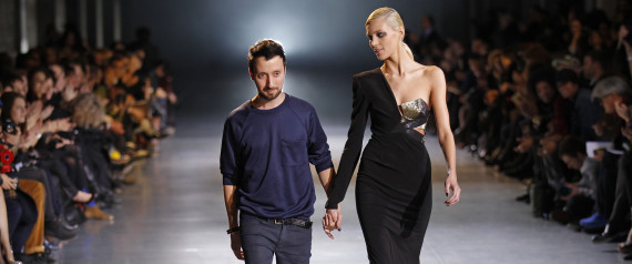 Designer Anthony Vaccarello appears with Polish model Anja Rubik at the end of his Fall/Winter 2012-2013 women's ready-to-wear fashion show during Paris fashion week February 28, 2012. REUTERS/Benoit Tessier (FRANCE - Tags: FASHION) - RTR2YL7P
