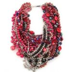 TOM-BINNS-red-in-JEWELED-pearls-at-COLETTE-on-fashiondailymag.com_