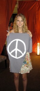 Taylor Swift WEARING PEACE LOVE WORLD in top 20 style icons of 2010 on fashiondailymag