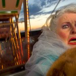 Old woman freaks out on ferris wheel.