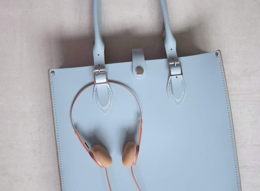 urbanears headphones on satchel tote bag