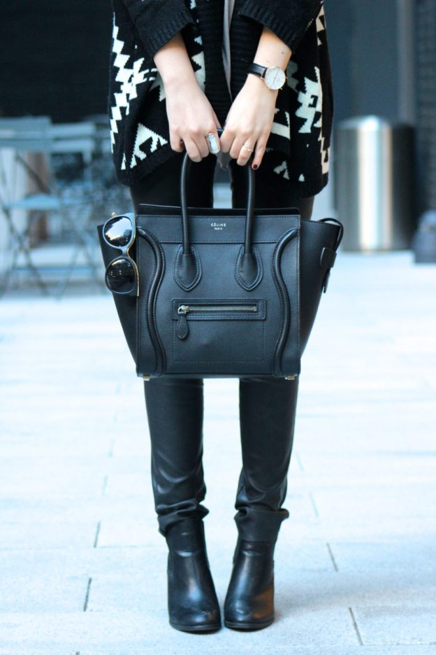 edgy fall outfit with leather pants and oversized sweater