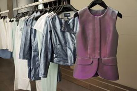 A metallic sheen pastel steel blue and pastel plum lame short sleeve peplum jacket. #EmporioArmani #Armani #fashionista411 #f411