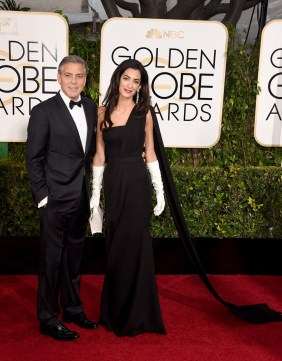 George Clooney in Giorgio Armani and Amal Alamuddin Clooney in Dior Haute Couture