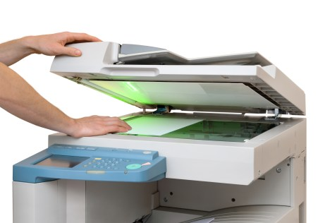 bigstock-Working-With-A-Copier-35835617