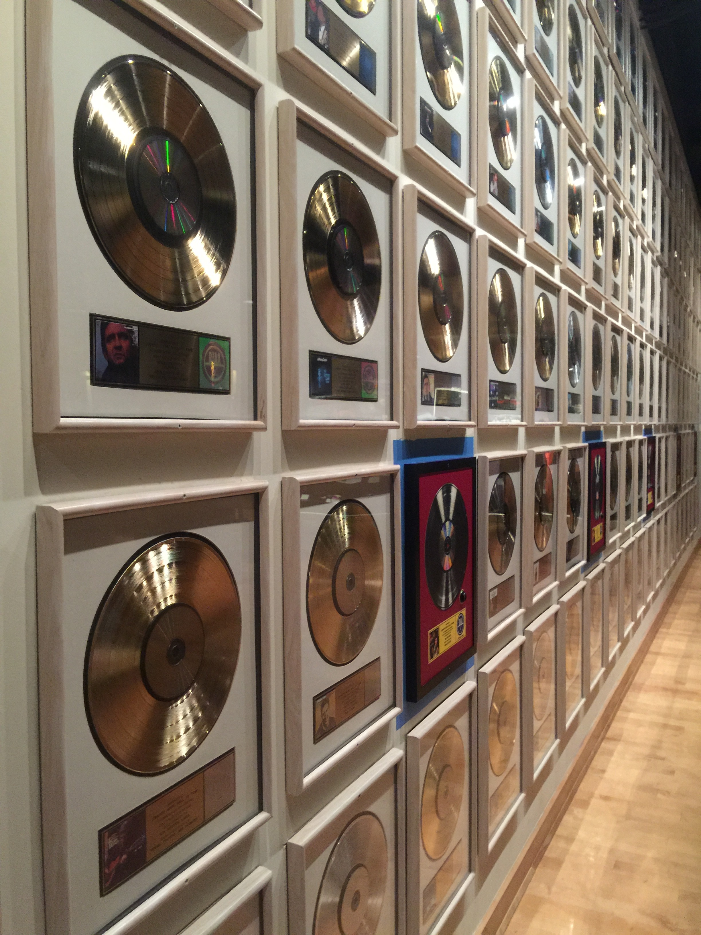 wall of award winning records by country music hall of fame inductees
