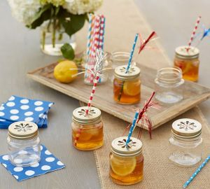 Keep the bees out our your lemonade with these mason jars, complete with decorative lids, napkins, straws, and firecracker toothpicks.