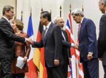 (L to R) Foreign Minister Guido Westerwelle, EU foreign policy chief Catherine Ashton, Chinese Foreign Minister Wang Yi, Iranian Foreign Minister Mohammad Javad Zarif, US Secretary of State John Kerry and French Foreign Minister Laurent Fabius shakes hands after a statement on early November 24, 2013 in Geneva. World powers reached an agreement with Iran over its nuclear programme, their chief negotiator Catherine Ashton and Iran's foreign minister said.    AFP PHOTO / FABRICE COFFRINI        (Photo credit should read FABRICE COFFRINI/AFP/Getty Images)