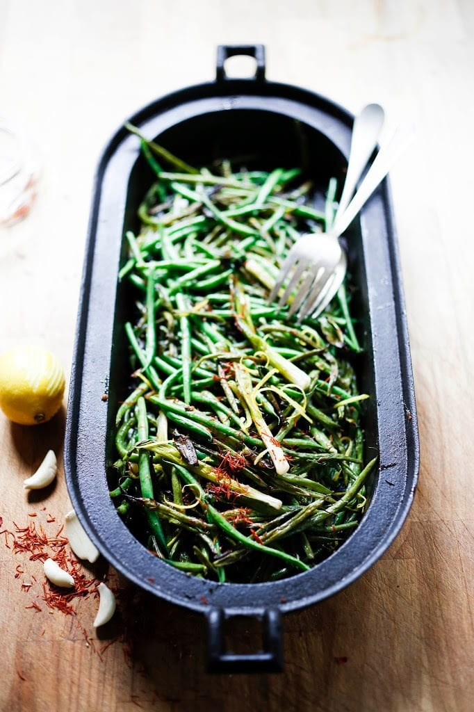 ... Roasted in the oven with scallions and lemon zest, these green beans