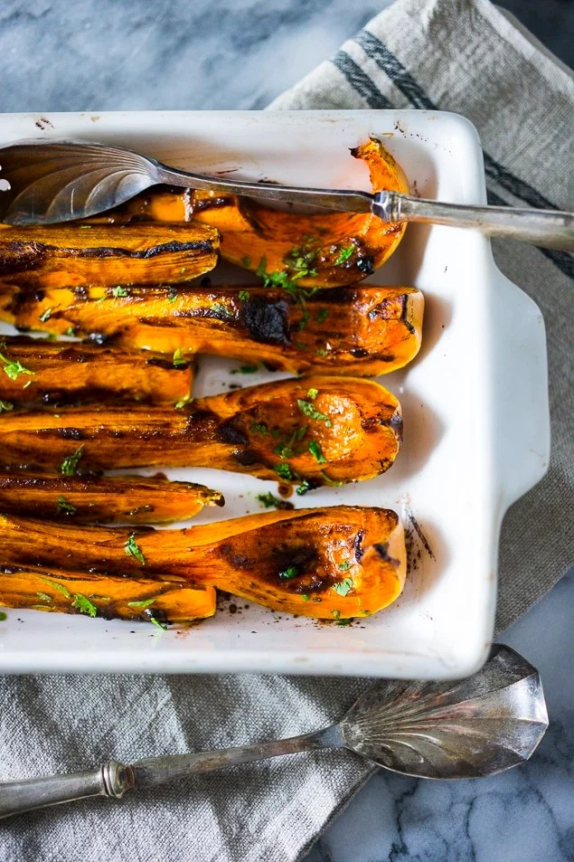 Savory roasted butternut squash with black garlic and miso paste...a delicious and easy fall side dish, this recipe is vegan and gluten free.