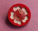 Red blossom brooch