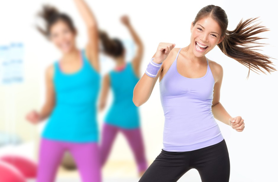 Fitness dance studio zumba class. Dancing woman in gym during exercise dancer workout training with happy fresh energy.