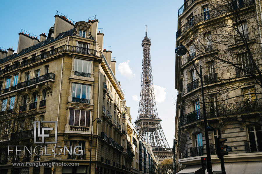 Eiffel Tower between buildings PreWedding Paris Photo Vacation 2016
