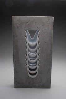 "Thomas Lowell Edwards, ""Ridge"" 2012, concrete, porcelain, 26 x 13 x 3""."