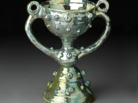 "Beatrice Wood, ""Blue Chalice"" 1985–88, lustre glaze, earthenware, 11.5 x 10 x 6""."