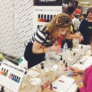 Dallas helping people make polish at my booth, with Roni & I in the background