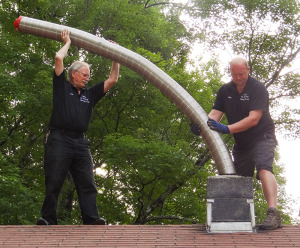 Len and Don Install Chimney Liner