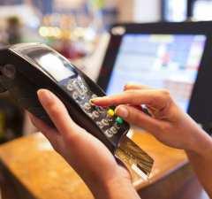 woman-credit-card-terminal