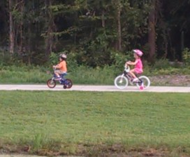 "My kids riding their new ""big brother"" and ""big sister"" bikes while we let mommy and the baby sleep."