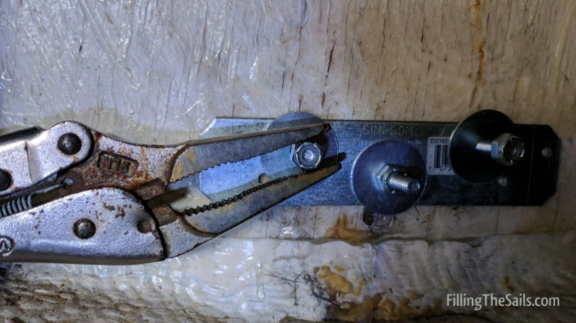 I wedged the pliers so it'd stay in place and allow the nuts to tighten on the bolt.