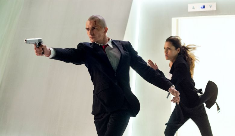 """DF-04496_04515_R -- Agent 47 (Rupert Friend) and Katia (Hannah Ware) are on the run in """"Hitman: Agent 47."""""""