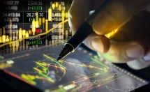 Financial stock market data. Candle stick graph chart of stock market ,stock market data graph chart on LED concept.(Slective focus on LED display)
