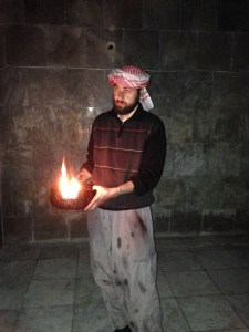 A Yazedi performing a lighting ritual at Shrine outside of Duhok, in Northern Iraq