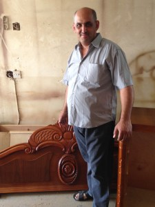 A Church leader in Baghdad, showing some of his hand-crafted furniture