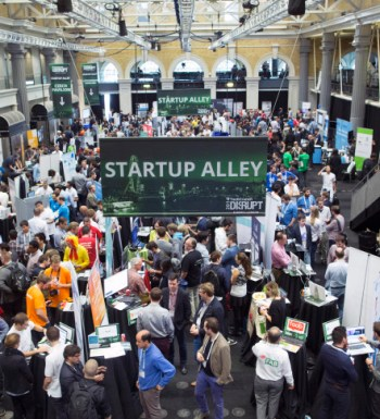 Exhibitors promote their business start-up companies in the main hall titled 'Startup Alley' at the Disrupt Europe 2014 conference in London, U.K., on Monday, Oct. 20, 2014. The TechCrunch event features representatives from global start-up companies involved in industries including medical diagnostics, enterprise mobile tools, and financial technology. Photographer: Jason Alden/Bloomberg via Getty Images