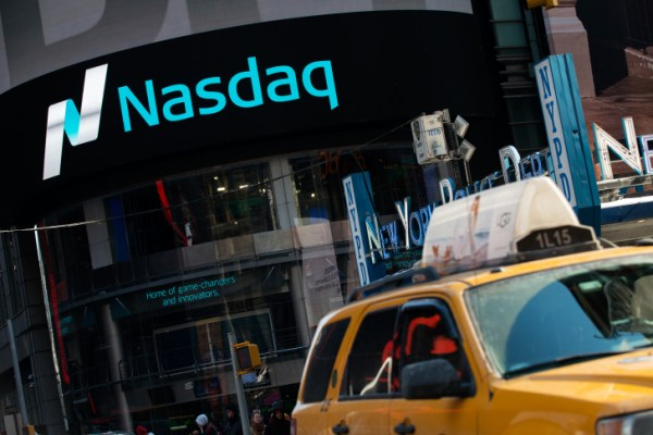 NEW YORK, NY - MARCH 02: Cars drive past the NASDAQ MarketSite on March 2, 2015 in New York City. The NASDAQ composite climbed over 5,000 points for the first time in 15 years when it briefly peaked over 5,000 points at 10:30 a.m. ET.  (Photo by Bryan Thomas/Getty Images)