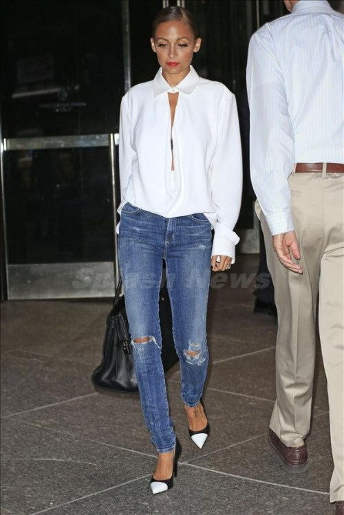 Nicole Richie wears ripped jeans while leaving her hotel in New York City