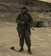 WW2 reenactor posing with rifle