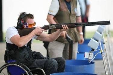 Photo of clay target shooting in a wheelchair