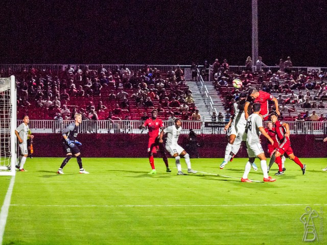Phoenix Rising FC's Chris Cortez, right, heads a corner from Shaun Wright-Phillips for Phoenix Rising's opening goal against Sacramento Republic FC Aug. 26, 2017 at the Phoenix Rising Soccer Complex in Scottsdale, Ariz. Photo by Aaron Blau/Firebird Rising
