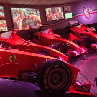 Winning Ferrari F 1 cars of Schumacher and Raikkonen in the Hall of Victories at the Ferrari Museum in Italy 2013