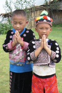 Hill-tribe children perform the wai.