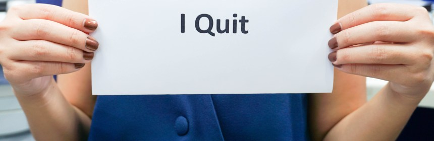 woman hold a banner of I quit to her boss