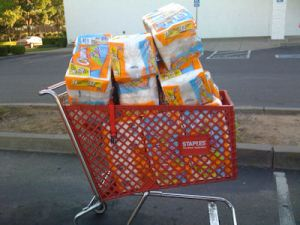 Staple Shopping Cart Filled with Toilet Paper
