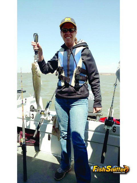 Rachel Kubiak with an eating sized striper caught while fishing chicken livers in Broad Slough in the West Delta.